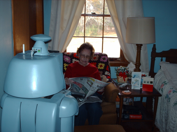 CareBot Watching Grandma Read the Paper